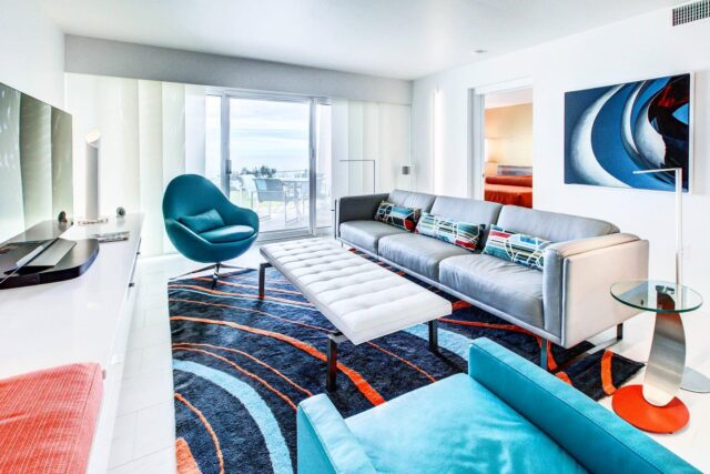 SLEEK YET COLORFUL 🧡💙 The Beach House condo was designed with the Gulf Coast in mind! @todd514 and the idMI team chose to create a gallery-like, smooth white canvas where artwork, furnishings, and accessories would POP. See more MODERN beach style when you check out this project on our new website at the #linkinbio!